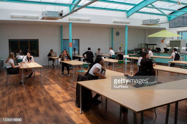 A general view of Year 10 pupils taking their break in the canteen Ortu Gable Hall School in Corringham Essex return after a long break due to the...