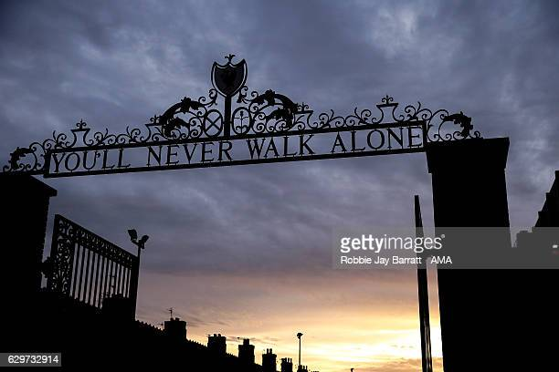 A general view of You'll Never Walk Alone signage outside Anfield the home stadium of Liverpool at dusk during the Premier League match between...