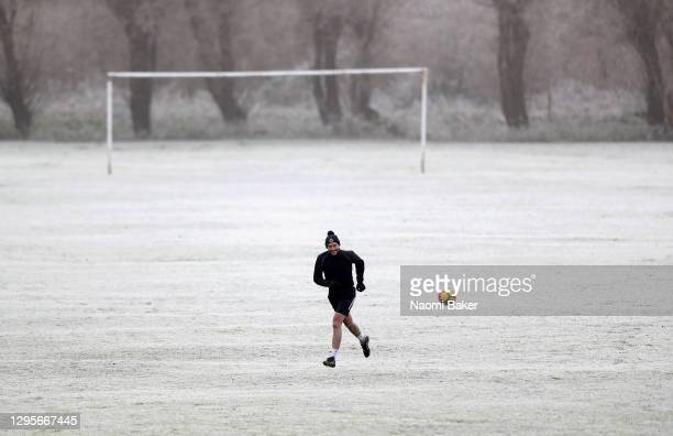 General view on a frosty cold morning of Convent Field as a member of the public plays football on his own at an empty football pitch on January 10,...