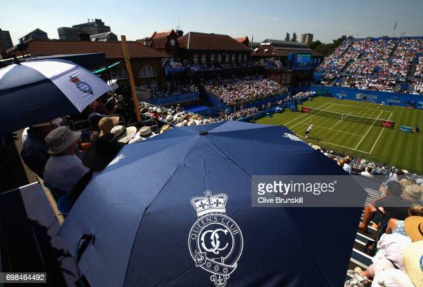 A general view on Centre Court as fans shield from the sun during the mens singles first round match between Stan Wawrinka of Switzerland and...