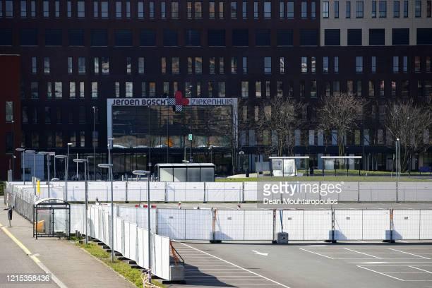 General view outside of the hospital car park with signs saying 'Coronamaatregelen bezoekers terrein Jeroen Bosch Ziekenhuis' or Corona measures for...