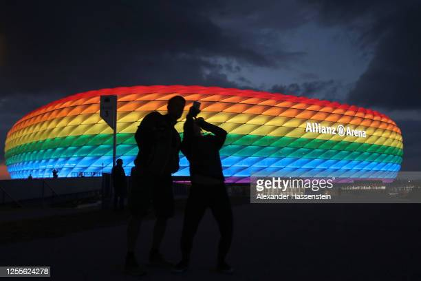 General view outside of the soccer stadium Allianz Arena which is illuminated in rainbow colours for Christopher Street Day on July 11, 2020 in...