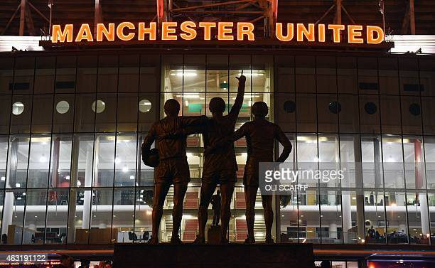A general view outside Old Trafford stadium and 'The United Trinity' statue of former Manchester United players George Best Denis Law and Bobby...