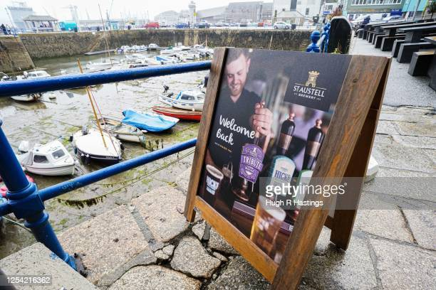 A general view outside the Chain Locker pub as it reopens for business on July 4 2020 in Falmouth Cornwall United Kingdom The UK Government announced...
