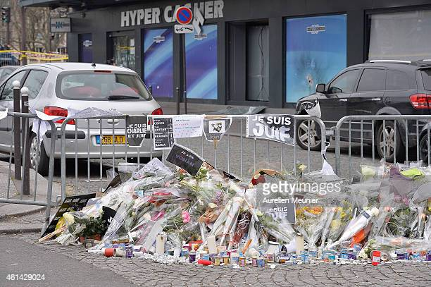 A general view outside the Jewish supermarket Hyper Cacher as Benjamin Netanyahu Prime Minister of Israel pays his respect to the victims following...