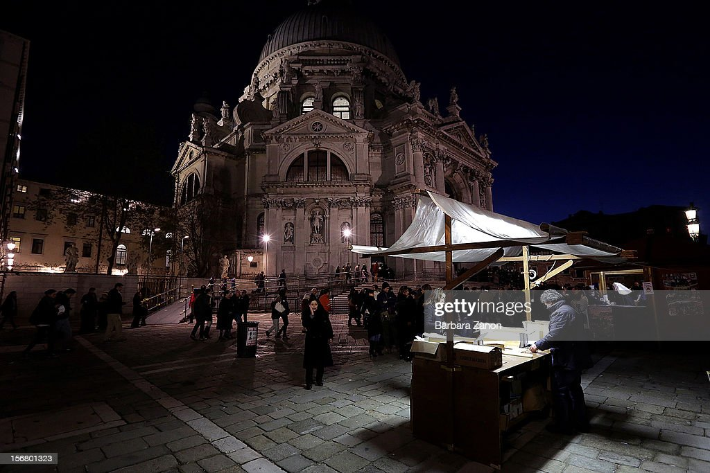 A general view outside the Santa Maria Della Salute Church during the Santa Maria Della Salute celebrations on November 21, 2012 in Venice, Italy. During the annual Santa Maria Della Salute celebrations, Venetians make pilgrimage to the Church to give thanks to the Virgin Mary (Maria), who is believed to have brought an end to the plague which struck the city in 1629.