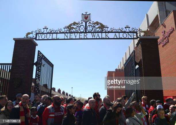General view outside the stadium as fans wait by the gates ahead of the Premier League match between Liverpool FC and Wolverhampton Wanderers at...