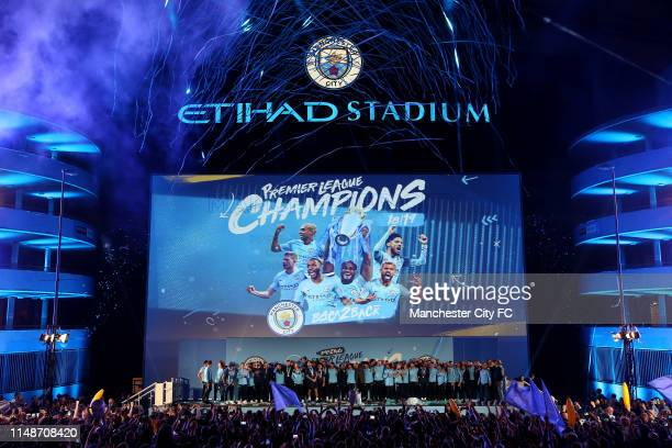 A general view outside the stadium as Manchester City celebrate in front of their fans with trophy after winning the Premier League Title at Etihad...