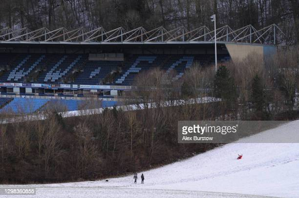 General view outside the stadium as people are seen sledging down a hill on the neighboring fields prior to The Emirates FA Cup Fourth Round match...