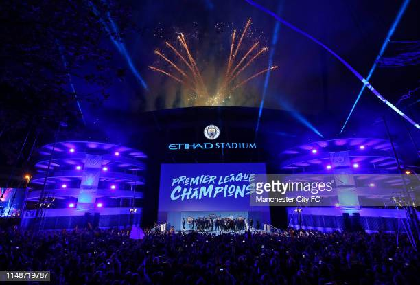 General view outside the stadium as the players of Manchester City celebrate in front of their fans with the trophy after winning the Premier League...