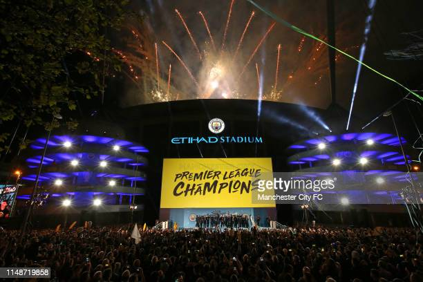 A general view outside the stadium as the players of Manchester City celebrate in front of their fans with the trophy after winning the Premier...