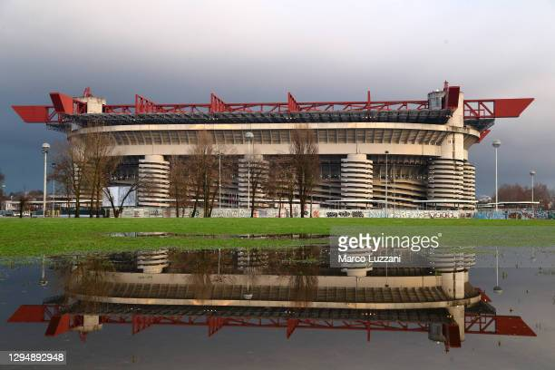General view outside the stadium as the stadium is reflected in a puddle during the Serie A match between AC Milan and Juventus at Stadio Giuseppe...