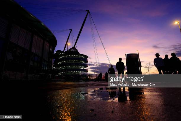 General view outside the stadium as the sun sets ahead of the Premier League match between Manchester City and Sheffield United at Etihad Stadium on...