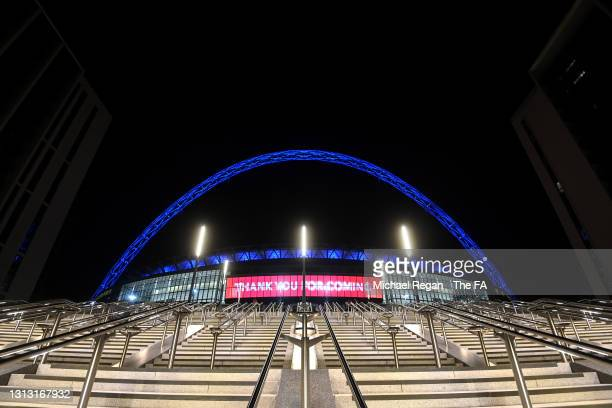 General view outside the stadium as the Wembley arch is coloured blue for Leicester City following their victory during the Semi Final of the...