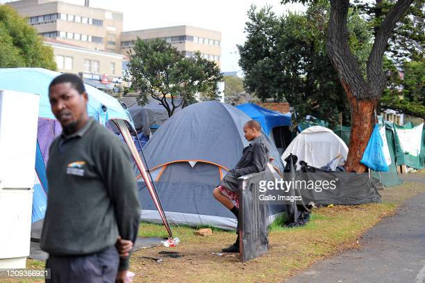 A general view people housed in tents and makeshift shelters and makeshift houses after being evicted from a building in Cape Town on Day Twelve of...
