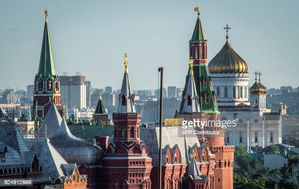 A general view photo taken on July 31 2017 shows the Kremlin the History Museum and the Cathedral of Christ the Savior in Moscow Russian president on...