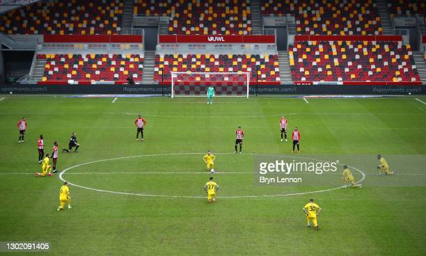 General view pre kick off as Barnsley players take the knee, as Brentford players stand before the Sky Bet Championship match between Brentford and...