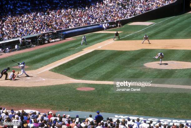 General view Sammy Sosa of the Chicago Cubs swings at a pitch during the game against the Montreal Expos on August 5, 1999 at Wrigley Field in...