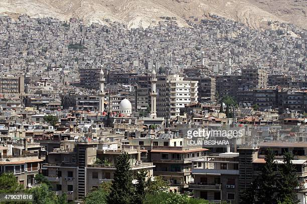 A general view shot taken on June 30 shows a neighbourhood in the Syrian capital Damascus AFP PHOTO / LOUAI BESHARA
