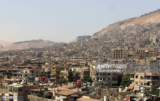 A general view shot taken on September 29 shows a neighbourhood in the Syrian capital Damascus AFP PHOTO / LOUAI BESHARA