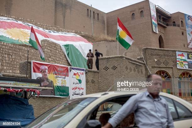 A general view show Kurdish flags and posters calling on people to vote on the Kurdish independence referendum in Arbil as Iraqi Kurds head to the...