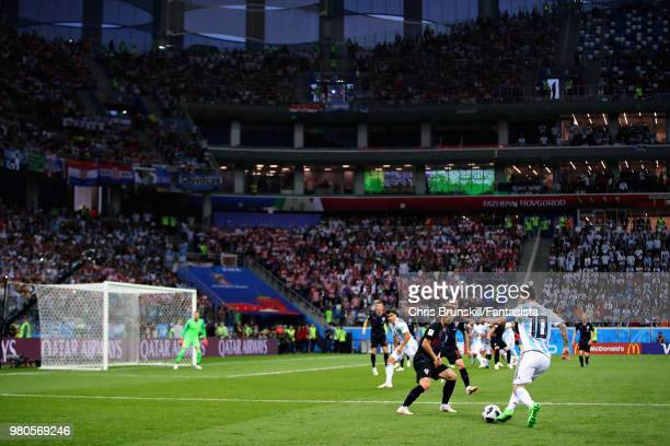 A general view showing Lionel Messi of Argentina running with the ball towards Luka Modric of Croatia during the 2018 FIFA World Cup Russia group D...