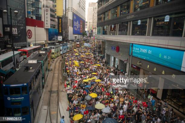General view showing people marching during a protest in Hong Kong, China. 28 April 2019 . Thousands march in protest against a new extradition law...