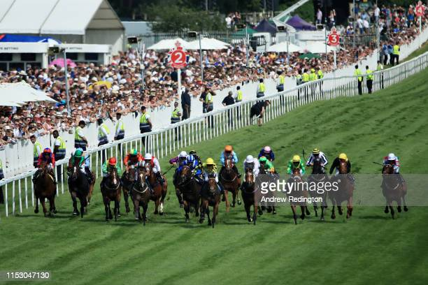 General view showing Phil Dennis riding Ornate leading the field in the Investec 'Dash' Handicap at Epsom Racecourse on June 01, 2019 in Epsom,...