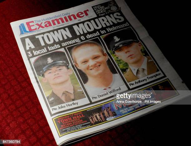 A general view showing the cover of the Huddersfield Examiner reporting on the deaths of three local soldiers in a blast in which six died in...