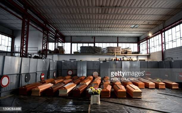 General view shows 35 coffins of deceased people stored in a warehouse in Ponte San Pietro, near Bergamo, Lombardy, on March 26, 2020 prior to be...
