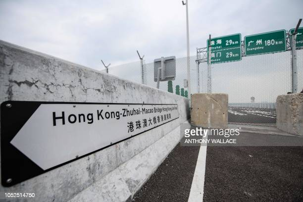 A general view shows a barrier on the Hong Kong side of the Hong KongZhuhaiMacau Bridge on October 19 five days ahead of its opening ceremony The...