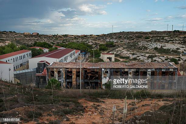 A general view shows a burnt building at the Temporary Permanance Centre refugee camp on the italian island of Lampedusa on October 6 2013 The fire...