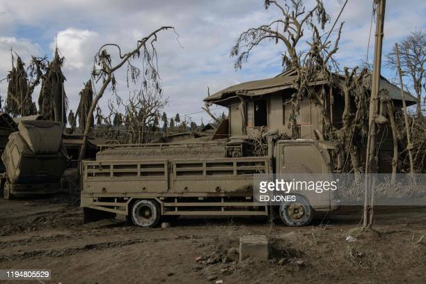 A general view shows a bus covered in ash by the eruption of the Taal volcano near Agoncillo on January 20 2020 Decimated fish scarred coffee plants...