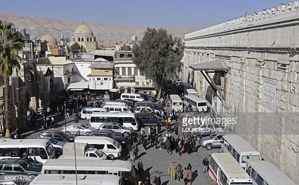 A general view shows a bus station outside the Hamidiyeh popular market in the old part of the capital Damascus on November 27 2016 / AFP / LOUAI...
