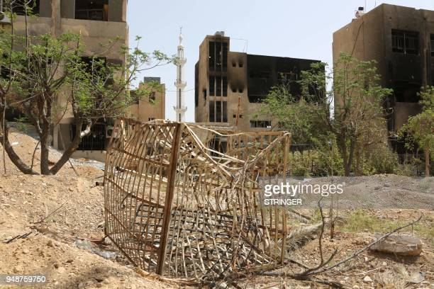 A general view shows a cage used by Jaish alIslam fighters to detain prisoners in the former rebelheld Syrian town of Douma on the outskirts of...