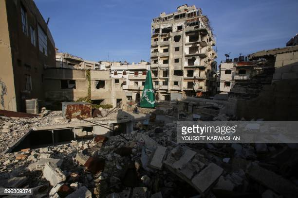 A general view shows a Christmas tree being decorated in the Christianmajority neighbourhood of Hamidiyeh in the old city of Homs on December 17 2017...