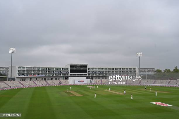 A general view shows a cloudy sky and the floodlights on during play on the second day of the second Test cricket match between England and Pakistan...