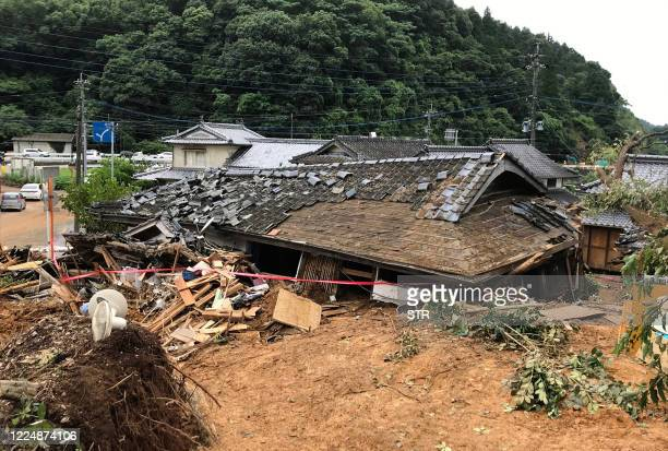 General view shows a collapsed house following a landslide caused by torrential rain in Ashikita, Kumamoto prefecture on July 5, 2020. - The floods...
