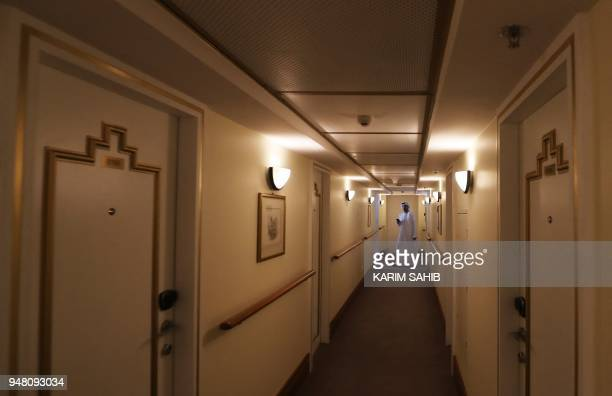 A general view shows a corridor of rooms on The Queen Elizabeth II luxury cruise liner also known as the QE2 docked at Port Rashid in Dubai where it...