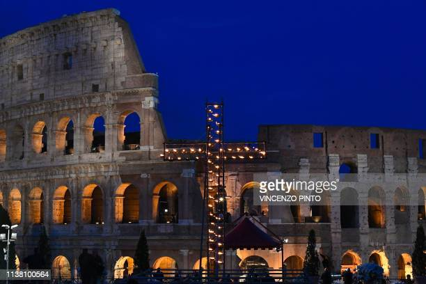 A general view shows a cross lit with candles by the Colosseum monument for the Via Crucis torchlight procession of Good Friday on April 19 2019 in...