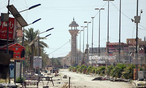 General view shows a damaged street in the centre of the city of Tikrit on April 15 as Iraqi federal police set up checkpoints in the city to guard...