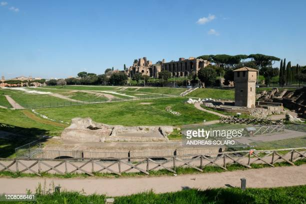 General view shows a deserted Circus Maximus, Rome's ancient Roman chariot-racing stadium and mass entertainment venue, on March 24, 2020 during the...