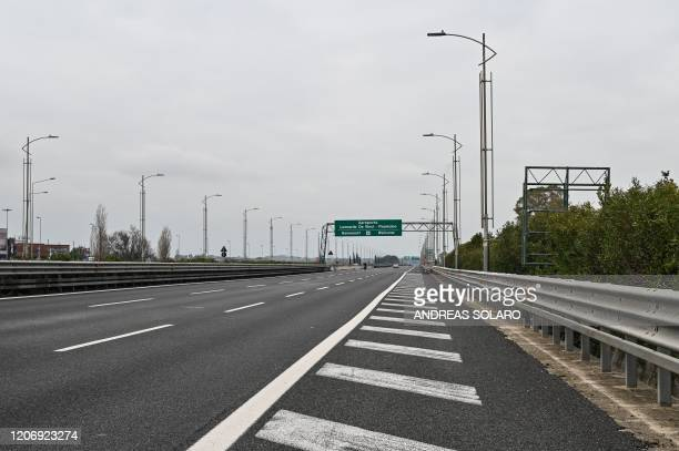 General view shows a deserted highway connecting Rome to Fiumicino's international airport on March 13, 2020 near Fiumicino. - Rome's Ciampino...