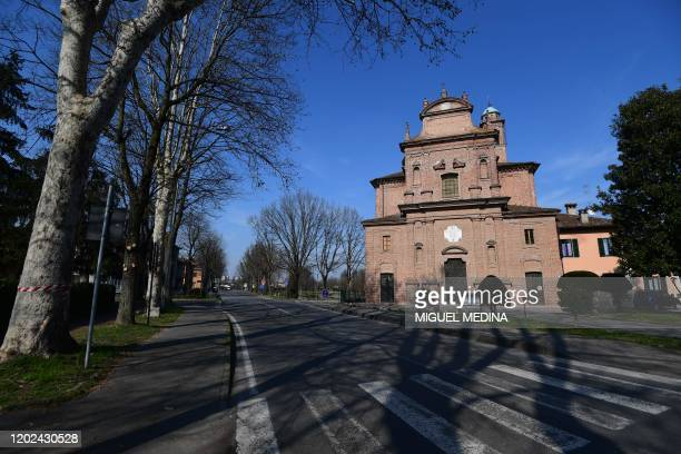 A general view shows a deserted street by the Santuario Beata Vergine di Caravaggio church in Codogno southeast of Milan on February 22 2020 Streets...