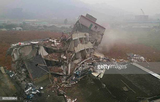 TOPSHOT A general view shows a destroyed building after a landslide hit an industrial park in Shenzhen south China's Guangdong province on December...