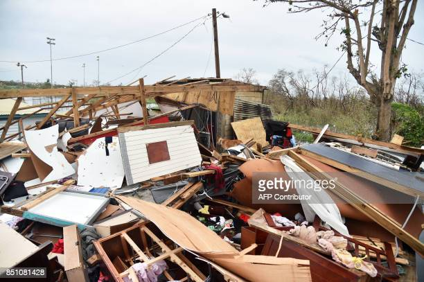 A general view shows a destroyed house in Catano town Puerto Rico on September 21 after Hurricane Maria slammed into the region leaving a deadly...