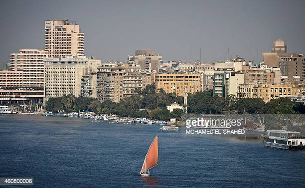 A general view shows a Felluca a traditional Egyptian boat sailing down Egypt's Nile river in Cairo on December 23 2014 AFP PHOTO / MOHAMED ELSHAHED