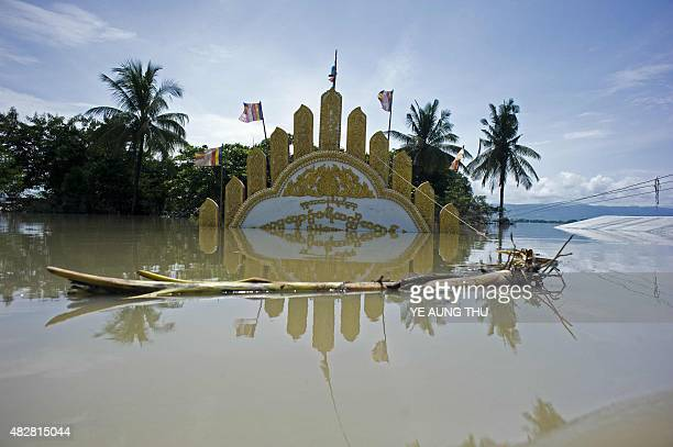 A general view shows a gate of a monestery submerged by floodwaters in Kalay upper Myanmar's Sagaing region on August 3 2015 Relentless monsoon rains...