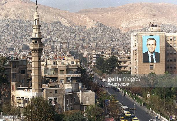 A general view shows a large portrait of Syrian President Hafez alAssad on a Damascus street 07 December 1999 US Secretary of State Madeleine...