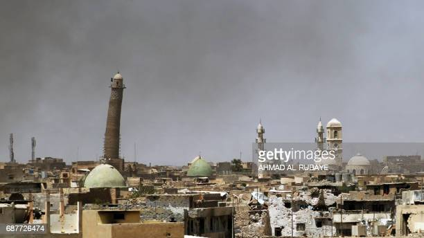 TOPSHOT A general view shows a leaning minaret and Nouri Mosque in the Old City of Mosul on May 24 during the ongoing offensive to retake the area...